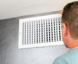 Man Looking at air vent