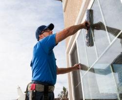 Man performing Window Washing